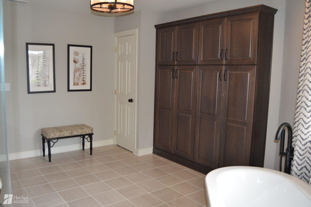 The warm wood vanities and natural stone tiles create a soothing space for these homeowners.