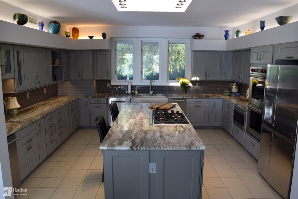 The large kitchen island provides extra seating on side and ample storage on the other.