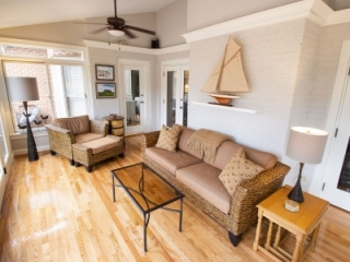 Painted Brick Wall In Sunroom Brightens Space