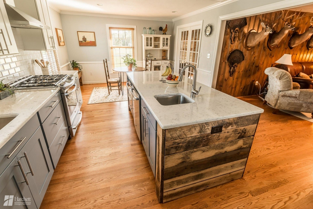 Hardwood floors from the living room extend into the Carr's new open concept kitchen.
