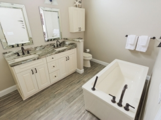 Bathroom designed with ample floorspace to share the room