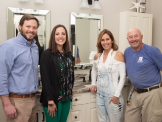 Happy client with her design team from Hatchett Design Remodel