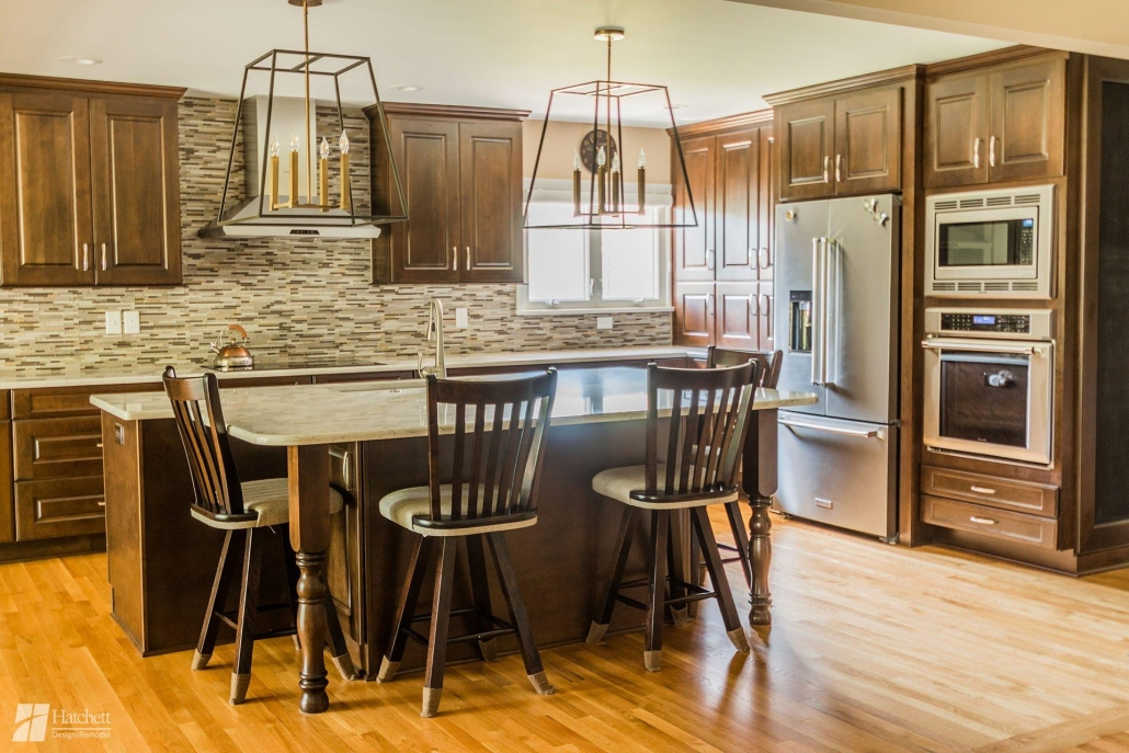 Installing cabinets and a tile backsplash that extends all the way to the ceiling makes a kitchen look larger.