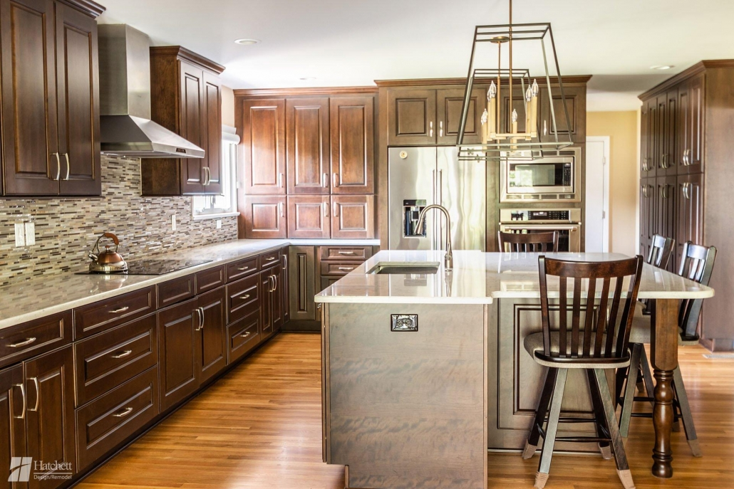 Mid Continent Cabinets: cherry with firestone stain and black glaze. Countertops: Silestone Lyra Quartz. Backsplash: Mineral Stix from Mosaic Tile.