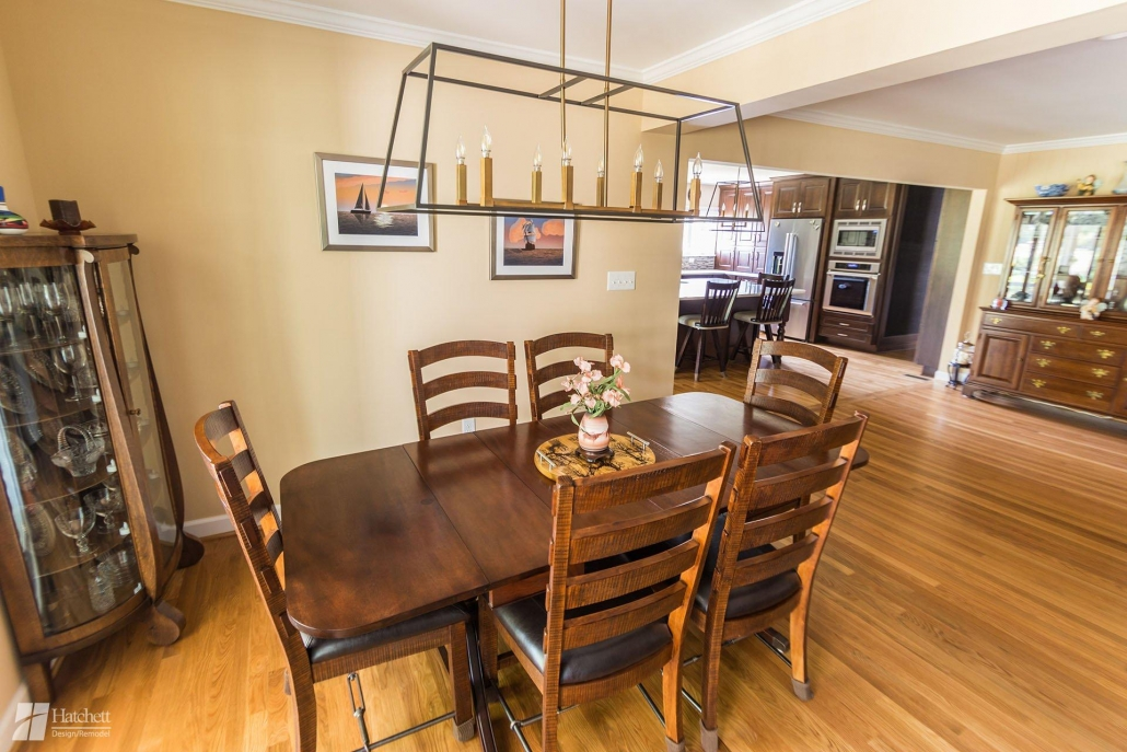 Hatchett installed a complementing chandelier over the dining room table to help tie the spaces together.