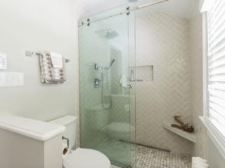 Basketweave shower floor tile with Moen shower fixtures