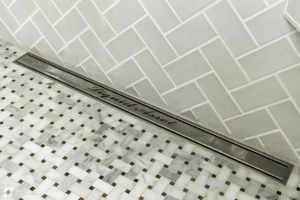 Side shower drain in master bathroom remodel