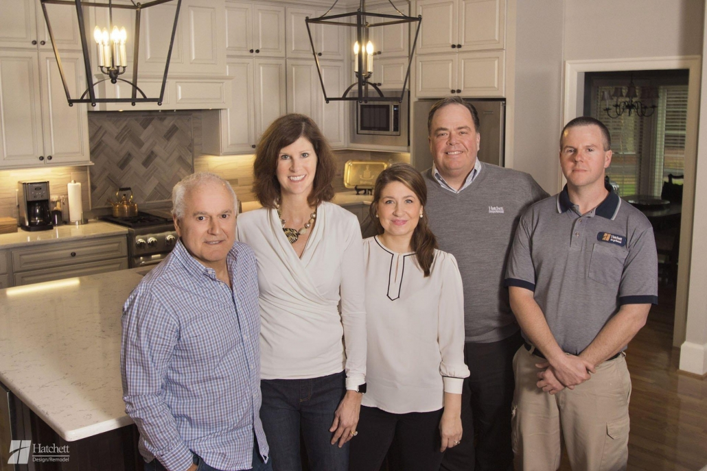 Hatchett's Design Team pictured with the Huntings after their remodel
