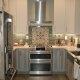Spangler Kitchen Remodel Two-Toned Cabinets Backsplash Tile Accent Stainless Steel Appliances
