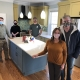The Mompers and Design Team in Remodeled Kitchen