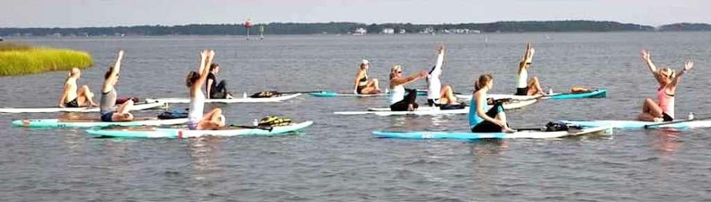 Suzy teaching paddleboard yoga